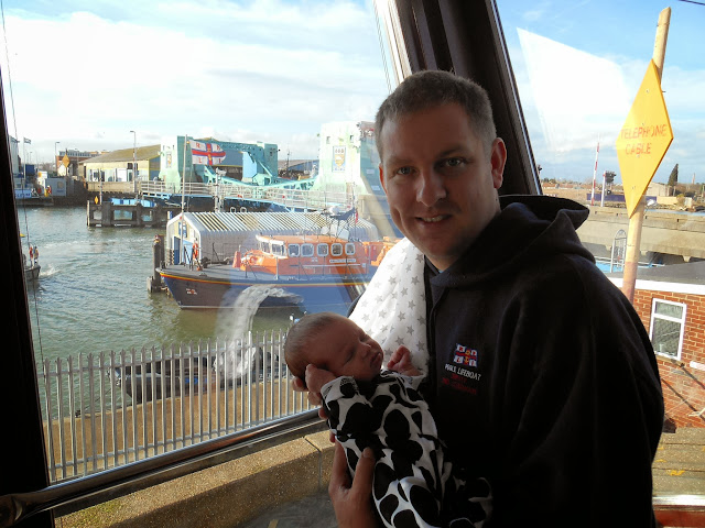 At 12 days old, little Bethan sleeps through her first visit to Poole Lifeboat Station. Obviously not as enthusiastic as her dad Dave! 12 January 2014 Photo: RNLI Poole