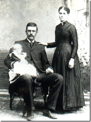 Lorenzo and Elizabeth Jane (Russell) Day with unidentified child
