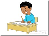 student sitting at desk writing in notebook