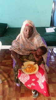 Amina Ali with her baby