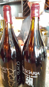 Bottles of Baco Noir from the Live Barrel, freshly bottled and signed by Tesoaria Winemaker John Olson