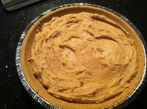 SPOON PEANUT BUTTER N CREAM CHEESE MIXTURE INTO GRAHAM CRACKER PIE N REFRIGERATE FOR...
