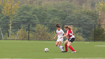 Ridgefield Park # 2 Nicole Osorio fights for the ball.   Photos by TOM HART/  FREELANCE PHOTOGRAPHER.