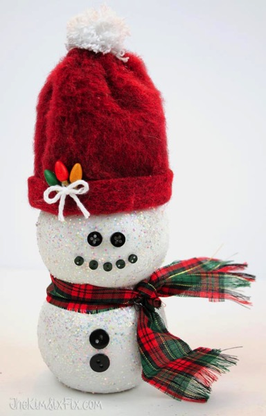 Plastic bottle snowman with santa hat