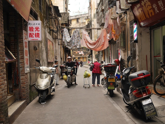sheets hanging over Wuya Lane in Shaoguan, Guangdong
