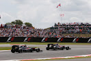 Fernando Alonso leads Jenson Button, McLaren MP4-30