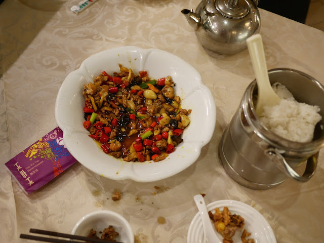 partly finished meal with a metal bucket of rice in Hengyang