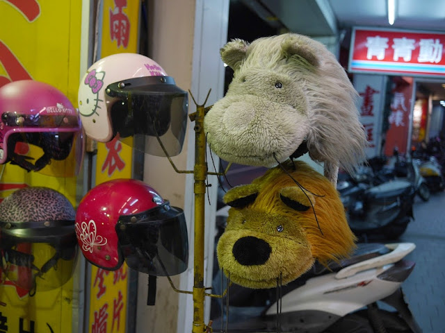 Scooter helmets with a Hello Kitty design, a butterfly design, and furry animal tops