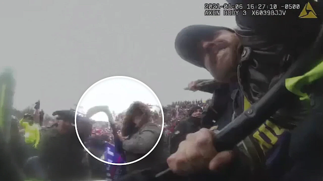 Body Camera Footage Shows Capitol Rioters Trampling Over Woman