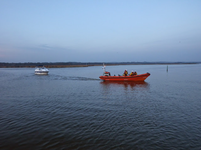 The ILB tows the stricken motor cruiser from the Wareham Channel towards Lake Pier - 31 October 2014. Photo credit: Dave Riley