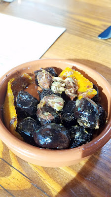 Lincoln Restaurant, Happy Hour item of oil cured olives and rosebuds with fennel pollen and orange