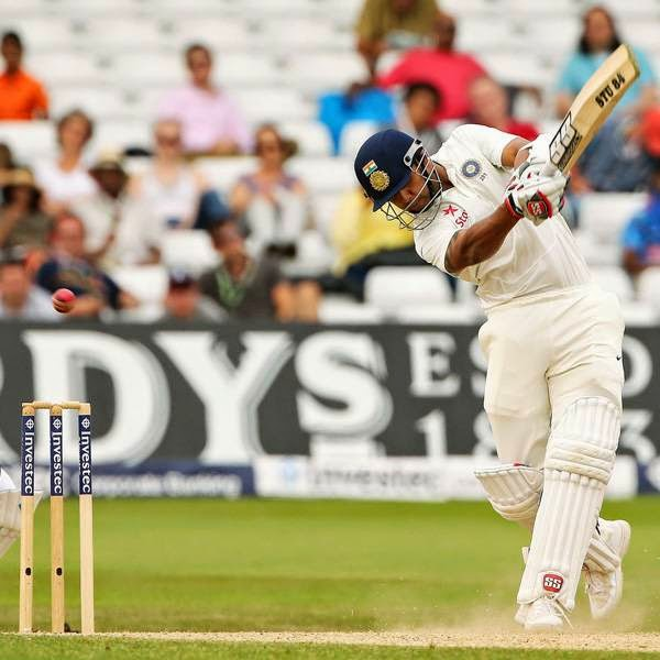 India's Stuart Binny (R) bats watched by England's Matt Prior (L) on the final day of the first cricket Test match between England and India at Trent Bridge in Nottingham, central England on July 13, 2014.