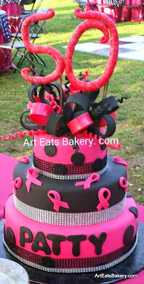 Lady's custom 50th birthday cake design with edible topper and bow, bling ribbon, breast cancer awarness ribbons and polka dots