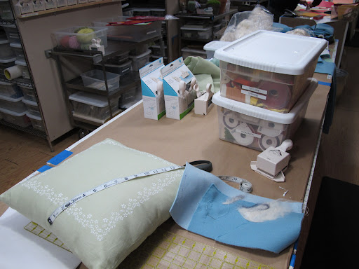 stenciled pillows getting prepped