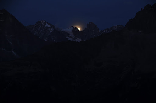 Moon rising over the Alps