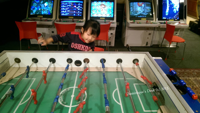 Tiger girl indulging in a game of table soccer