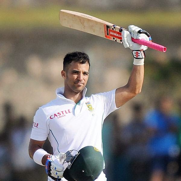 South Africa cricketer JP Duminy raises his bat in celebration after scoring a century (100 runs) during the second day of the opening Test match between Sri Lanka and South Africa at the Galle International Cricket Stadium in Galle on July 17, 2014.