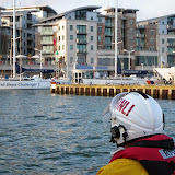 Poole ILB Helmsman Glen Mallen checking the space available to bring Dolphin III alongside the quay during a training exercise - 22 April 2014 Photo: RNLI Poole/Anne Millman