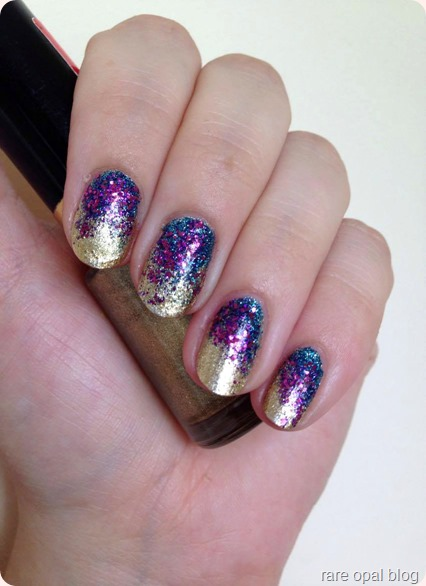 gold glitter nails using blue and purple jewel toned glitter. Revlon Gold Coin, Milani One Coat Glitter Blue Flash and Essence Special Effect Topper in Only Purple Matters. Sveta Sanders nail art look
