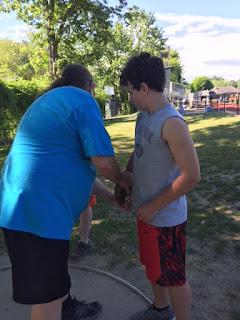 Dr. John McMahon coaching athlete on discus grip
