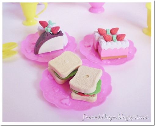 The plates now piled with sandwiches and delightful cakes, all erasers of course.