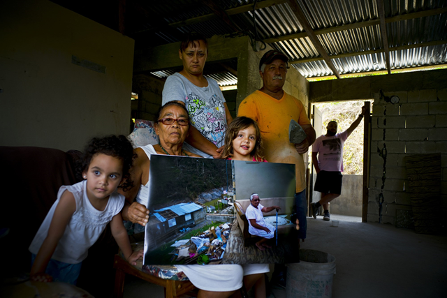 Juana Sostre Vazquez holds a photo of her taken after Hurricane Maria destroyed her home on 26 May 2018. Vazquez lives on food stamps and social security payments. Photo: Ramon Espinosa / AP