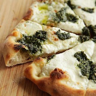 Pizza with Pesto, Ricotta, and Mozzarella.