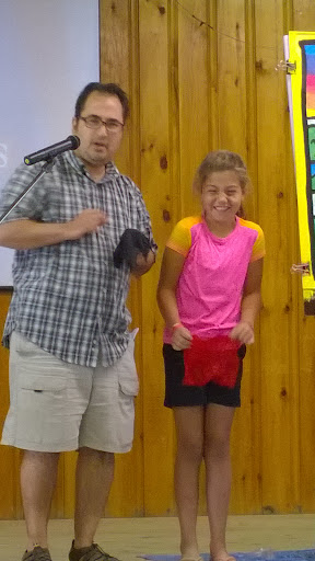"This camper was helping me with a ""gospel magic trick"" and apparently was enjoying it. Great laugh!"