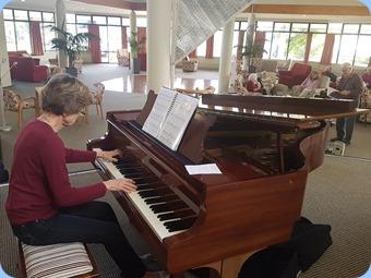 Denise Gunson playing the Steinway grand piano.