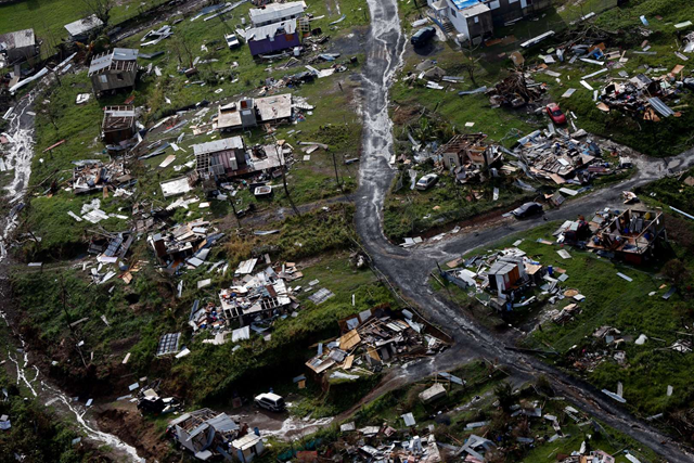 Aerial view of a destroyed community in the aftermath of Hurricane Maria in Toa Alta, Puerto Rico, 28 September 2017. Photo: Gerald Herbert / AP Photo