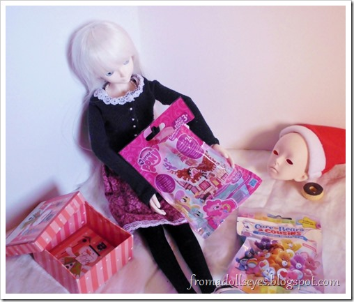 A ball jointed doll opening Chrismas presents, they're blind bags!