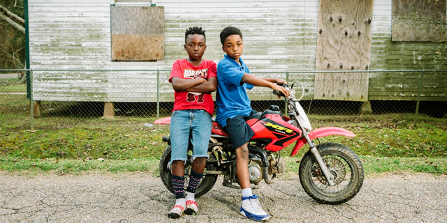 Two boys who live near the Dupont/Denka plant in Reserve, St. John the Baptist Parish, Louisiana, on 20 February 2017.  According to the EPA's most recent National Air Toxics Assessment, which was published in December 2015, the lifetime risk of cancer from air pollution in this area, which is less than 2 square miles, is a staggering 777 per million people, by far the highest in the country and more than 800 times the national average. Photo: William Widmer / The Intercept