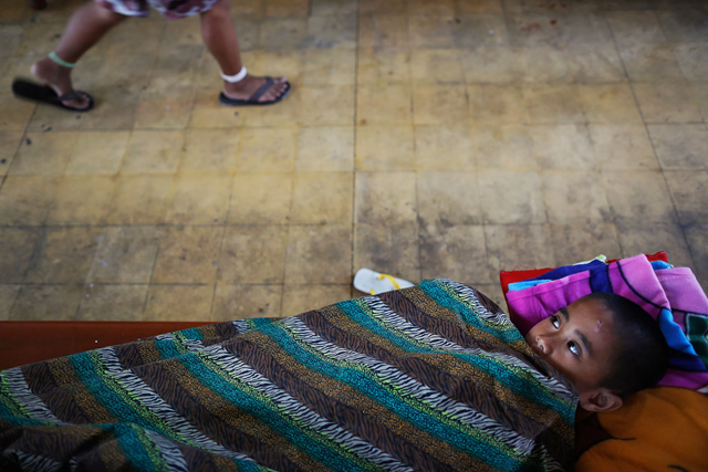 Hundreds of survivors of Typhoon Haiyan found shelter in a Tacloban church after the disaster. Photo: Damir Sagolj / Reuters