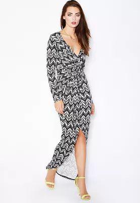 c7d5222c8 تفاصيل فستان مطبوع ماركة كلوب ال نسيج فيسكوز مطاطي و ناعم ملفوف من الأمام  حافة متباينة الطول ياقة بشكل v و اكمام طويلة طباعة متعرجة بطول الفستان