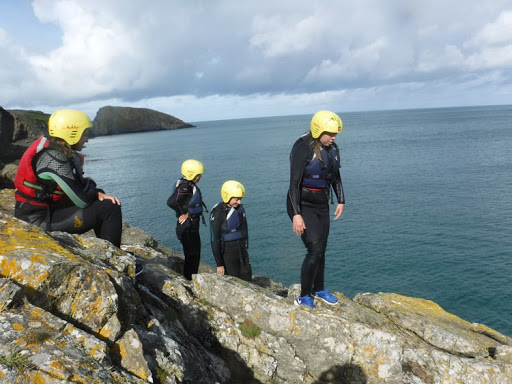 Here's our group coasteering along the coast of Wales. It's a sport in which travelers explore a rocky coastline by climbing, jumping and swimming.