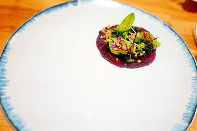 Farm Spirit Dinner in February 2016 - all vegan fine dining, this is Warm smoked beets and preserved wild blackberries with fir, petite greens, and buckwheat