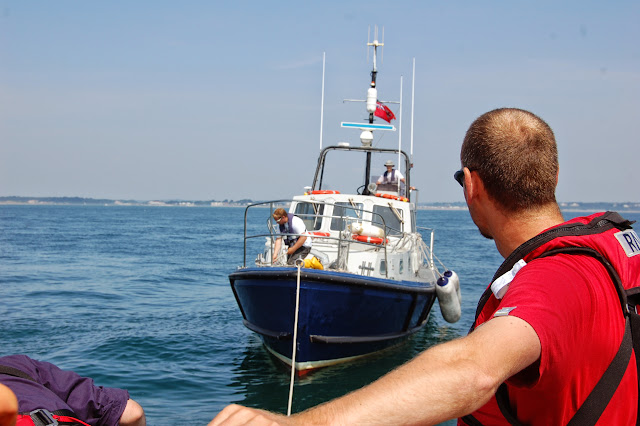 Trainee Crew Member Steve Porter observing the setting up of a tow rope Photo: RNLI Poole/Dave Riley