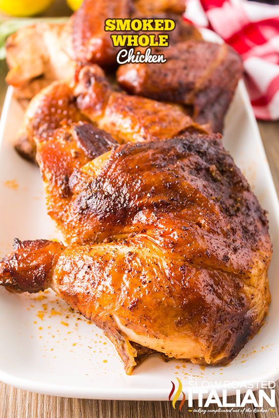 Smoked Whole Chicken cut up and on a white platter
