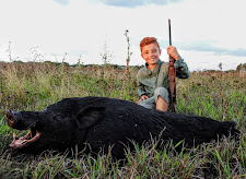 Young Mr Trovato with his first wild boar, a very big one at that!