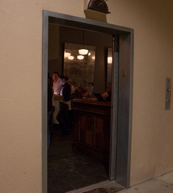photo of the elevator opened to reveal the restaurant