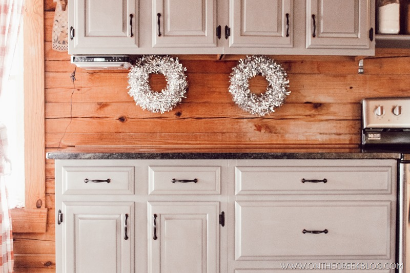 Silver & sparkly wreaths from Dollar Tree used as New Year's kitchen decor!