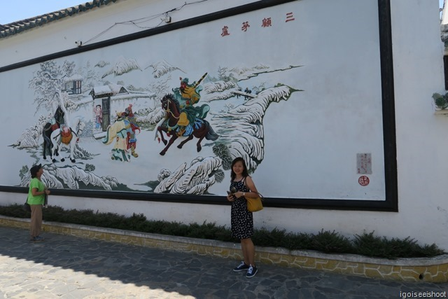 Mural with Chinese General Quan Cong on a horse at the garden in the rear of the Quang Trieu (Canton) Assembly Hall in Hoi An ancient town