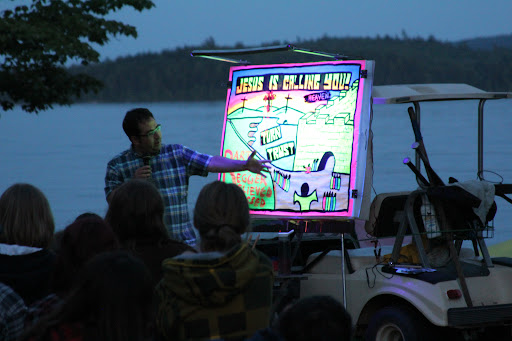 """As it got darker out, the black light and fluorescent paint made the message """"glow in the dark."""" The kids really understood that they needed to turn from their sins and trust in Jesus!"""