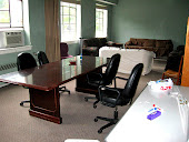 This is our meeting/hang out room with donated couches & a board room table.