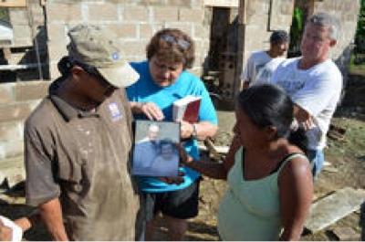Local volunteers help build houses in honor of loved ones in Belize