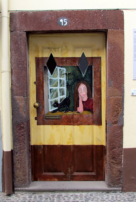 girl standing at the window - Santa Maria street in old town