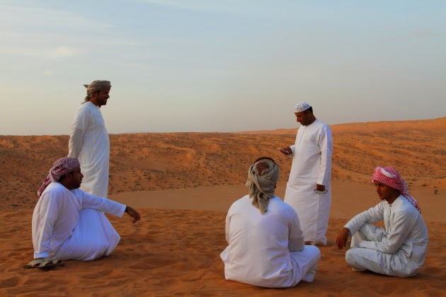 Omani men take a break from dune bashing at Wahiba Sands