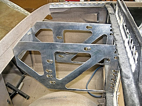 Photo: Radio Cage.  Bolts to Instrument Panel with Flanges and to F-28 with nut plates.