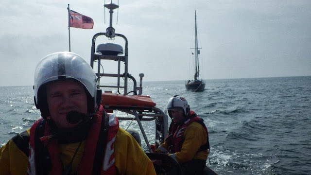James Kilburn at the helm of the ILB - 23 August 2013.  Photo credit: RNLI/Poole
