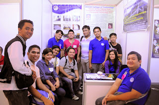 MCCID alumni visits the booth.